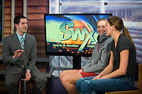SPOKANE, WA - MARCH 29, 2013: Sisters Joslyn and Elle Tinkle record an on-air interview with KHQ sports.