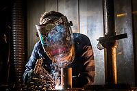 Welding and Non Destructive Testing student Tia Thompson in UAA's weld lab at Gordon Hartlieb Hall.