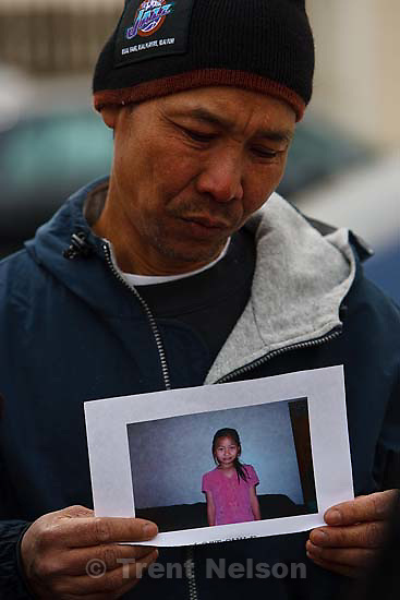 South Salt Lake - Cartoon Wah, father of missing seven-year-old Hser Ner Moo speaks outside of the family's apartment, Tuesday, April 1, 2008. .; 4.01.2008