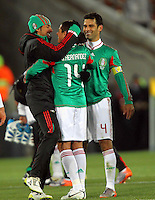 Javier Hernandez of Mexico celebrates at the end of the game with Rafael Marquez