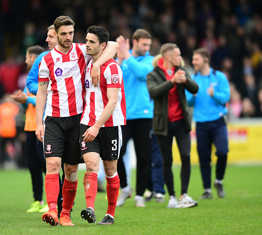 Lincoln City's Luke Waterfall, left, and Sam Habergham at the end of the game<br /> <br /> Photographer Chris Vaughan/CameraSport<br /> <br /> Vanarama National League - Lincoln City v Torquay United - Friday 14th April 2016  - Sincil Bank - Lincoln<br /> <br /> World Copyright &copy; 2017 CameraSport. All rights reserved. 43 Linden Ave. Countesthorpe. Leicester. England. LE8 5PG - Tel: +44 (0) 116 277 4147 - admin@camerasport.com - www.camerasport.com