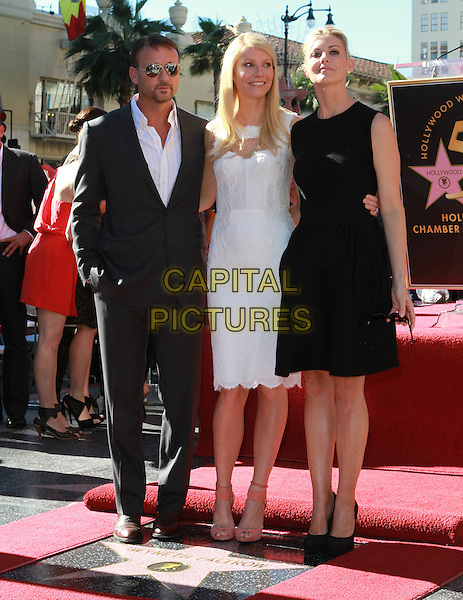 TIM McGRAW, GWYNETH PALTROW & FAITH HILL .Gwyneth Paltrow Hollywood Walk Of Fame Star Induction Ceremony held On The Walk Of Fame, Hollywood, CA, USA 13th December 2010..full length sleeveless white dress cut out grey gray suit sunglasses black wife husband couple shoes .CAP/ADM/KB.©Kevan Brooks/AdMedia/Capital Pictures.