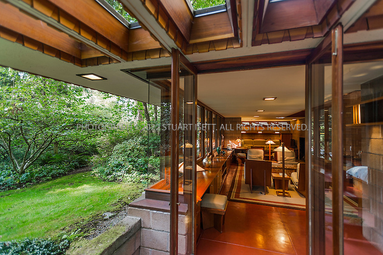"""10/9/2012--Sammamish, WA, USA..VIEW: Exterior showing living room...Architect Frank Lloyd Wright planned his """"Usonian"""" homes to be affordable for middle-class families. The 1,9500 square foot Brandes home is for sale in Sammamish, Washington (30 minutes from Seattle) at $1.39 million. It features three bedrooms, two bathrooms and a small, separate office/study space...The home was built in 1952, and has redwood trim and Wright's original furniture and some garden sculptures by Wright. It's one of only three Frank Lloyd Wright homes near Seattle...©2012 Stuart Isett. All rights reserved."""