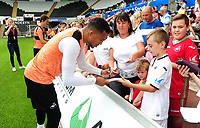 Swansea City's Martin Olsson with fans during the Swansea City Training at The Liberty Stadium, Swansea, Wales, UK. Tuesday 07 August 2018