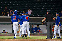 AZL Cubs manager Carmelo Martinez is restrained by assistant hitting coach Leonel Perez (66) during an argument with home plate umpire Ray Patchen after Yovanny Cuevas (61) was called out for batter interference against the AZL Giants on September 6, 2017 at Sloan Park in Mesa, Arizona. AZL Giants defeated the AZL Cubs 6-5 to even up the Arizona League Championship Series at one game a piece. (Zachary Lucy/Four Seam Images)