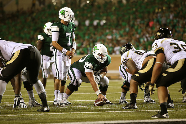 DENTON, TX - AUGUST 31: North Texas Mean Green quarterback Derek Thompson (7) and offensive linesman Kaydon Kirby (50) of the North Texas Mean Green Football vs Idaho Vandals at Apogee Stadium in Denton on August 31, 2013 in Denton, Texas. Photo by Rick Yeatts