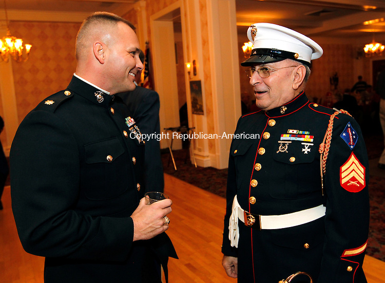 Torrington, CT- 10, November 2010-111010CM07  Major Mark Cameron (C. Company our of Plainville), (left) shares a laugh with Sgt. Tony Boucino (right) of Torrington Wednesday night at the Elks Lodge in Torrington.  The two were celebrating the Corps' 235 birthday.   Christopher Massa Republican-American