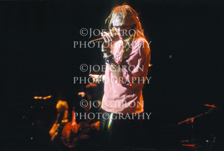 Various portraits & live photographs of the rock band, Guns N' Roses
