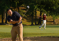 A golfer hits from a sand trap at Rolling Hills Country Club in Monroe, NC.