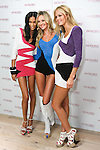 "Chanel Iman, Candice Swanepoel, and Erin Heatherton pose together during the ""Incredible by Victoria's Secret"" launch at the Victoria Secret SOHO Store, August 10, 2010."