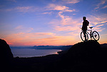 A mountain biker along the Tahoe Rim Trail above Tahoe City at sunset.