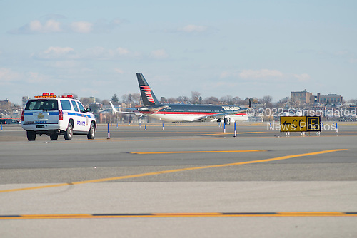 President-elect Trump's private plane taxis on the tarmac at Laguardia Airport as Mr. Trump departs for a series of visits to Indianapolis and Cincinnati, in New York, NY, USA on December 1, 2016. <br /> Credit: Albin Lohr-Jones / Pool via CNP