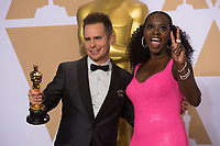 Viola Davis (right) and Sam Rockwell pose backstage with the Oscar&reg; for performance by an actor in a supporting role, for work on &ldquo;Three Billboards Outside Ebbing, Missouri&rdquo; during the live ABC Telecast of The 90th Oscars&reg; at the Dolby&reg; Theatre in Hollywood, CA on Sunday, March 4, 2018.<br /> *Editorial Use Only*<br /> CAP/PLF/AMPAS<br /> Supplied by Capital Pictures<br /> <br /> *Editorial Use Only*<br /> CAP/PLF/AMPAS<br /> Supplied by Capital Pictures