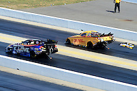 Apr. 14, 2012; Concord, NC, USA: NHRA funny car driver Jeff Arend (right) loses the right side spill plate racing alonside Tony Pedregon during qualifying for the Four Wide Nationals at zMax Dragway. Mandatory Credit: Mark J. Rebilas-