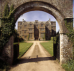 View of Chastleton House looking through the arch of the Entrance Gate showing the driveway leading to the house.