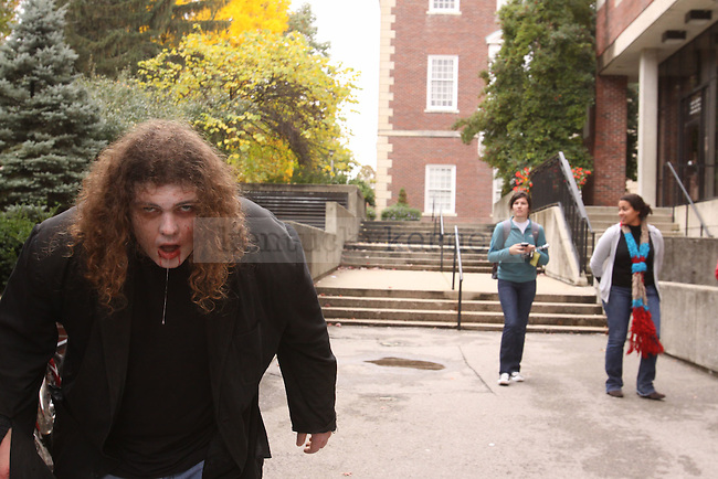 Theatre senior Elliot Richards walks campus as a zombie catching the attention of UK students on Wednesday. Photo by Scott Hannigan | Staff