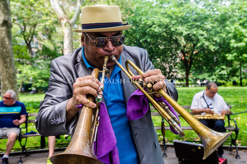 New York, USA - 4 June 2016 Trumpeteer playing two trumpets in Washington Square Park ©Stacy Walsh Rosenstock
