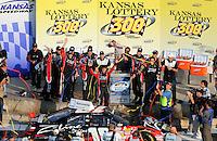 Sept. 27, 2008; Kansas City, KS, USA; NASCAR Nationwide Series driver Denny Hamlin celebrates after winning the Kansas Lottery 300 at Kansas Speedway. Mandatory Credit: Mark J. Rebilas-