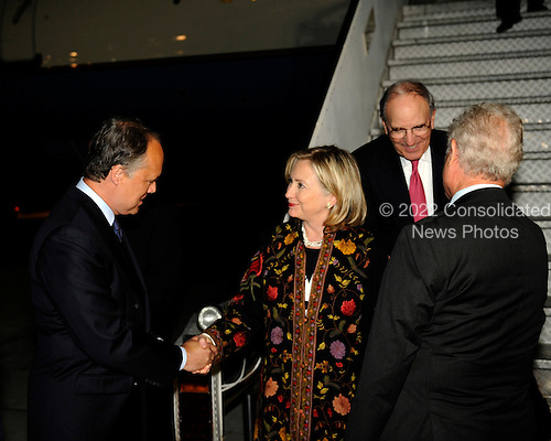United States Secretary of State Hillary Rodham Clinton (center) and Special Envoy for Middle East Peace George C. Mitchell (second from right) are welcomed upon arrival to Israel by Israeli Chief of Protocol Ambassador Yitzhak Eldan (left) and U.S. Ambassador to Israel James Cunningham (bottom right) in Tel Aviv on Tuesday, September 14, 2010. .Credit: Department of State via CNP.