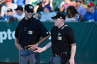 Home plate umpire Marc Lindsey and base umpire Patrick Sharshel in Pioneer League play as the Ogden Raptors faced the Great Falls Voyagers at Lindquist Field on August 14, 2013 in Ogden Utah. (Stephen Smith/Four Seam Images)