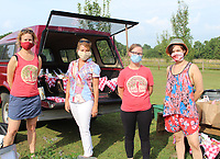 Mary Thompson, Apple Seeds executive director (from left); Tanya Collins, marketing director; Becky Miller, program manager; and Chef Haley O'Brien welcome help out at the Picnic Pickup on July 16 at the teaching farm in Fayetteville.<br /> (NWA Democrat-Gazette/Carin Schoppmeyer)
