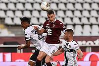 20th June 2020, Turin, Italy, Serie A football league, Torino versus Parma; Andrea Belotti-Bruno Alves-Riccardo Gagliolo Pchallenge for a loose ball