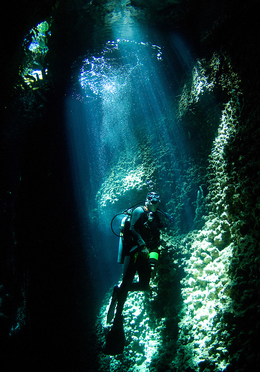 A diver explores the amazing underwater cavern known as Lerus Cut, Russell Islands, Solomons