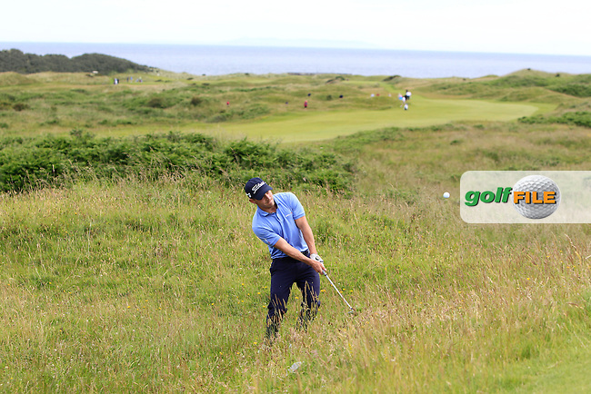 Daniel Holland (Castle) in the rough on the 3rd during Round 3 Matchplay of the North of Ireland Amateur Open Championship at Royal Portrush, Dunluce Course on Thursday 16th July 2015.<br /> Picture:  Golffile | Thos Caffrey