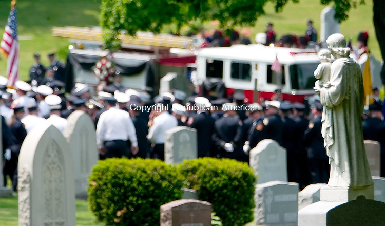 WATERBURY, CT- 25 MAY 07- 052507JT05- <br /> Firefighters from surrounding regions gathered at Calvary Cemetery in Waterbury on Friday for the funeral of Capt. John Keane. Keane was killed due to injuries suffered when two fire trucks collided at East Aurora Street and Route 73 in Waterbury on Saturday, May 19.<br /> Josalee Thrift Republican-American