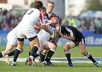 England skipper Hugo Ellis is tackled by New Zealand number 8 Liukanasi Manu during the Division A U19 World Chanpionship match at Ravenhill, Belfast.