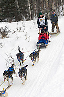 G.B. Jones w/Iditarider on Trail 2005 Iditarod Ceremonial Start near Campbell Airstrip Alaska SC