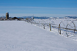 Idaho,Coeur d' Alene. Snow scene of Farm buildings, irrigation lines and an old silo on the Rathdrum Prairie in winter.
