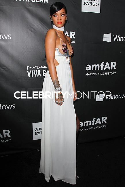 HOLLYWOOD, LOS ANGELES, CA, USA - OCTOBER 29: Rihanna arrives at the 2014 amfAR LA Inspiration Gala at Milk Studios on October 29, 2014 in Hollywood, Los Angeles, California, United States. (Photo by Celebrity Monitor)
