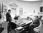 Washington, D.C. - December 14, 1972 -- United States President Richard M. Nixon,left, meets with Doctor Henry A. Kissinger, right, and General Alexander M. Haig, Jr., center, in the Oval Office in the White House in Washington, D.C. on December 14, 1972..Credit: White House via CNP