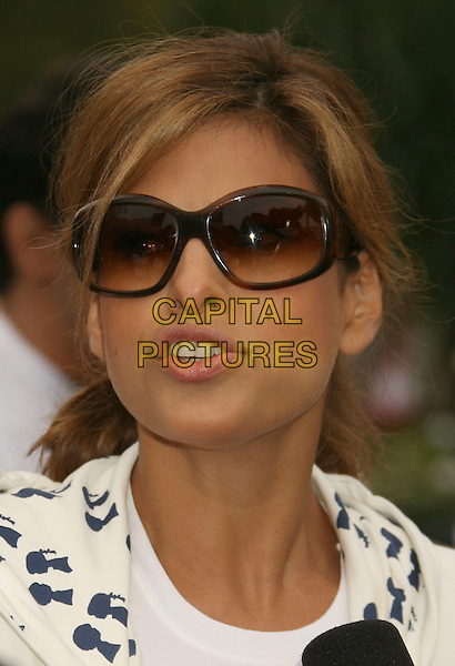 EVA MENDES.14th Annual Entertainment Industry Foundation Revlon Run/Walk For Women held at The Los Angeles Memorial Coliseum, Los Angeles, California, USA,.12 May 2007..portrait headshot sunglasses  mouth open funny.CAP/ADM/RE.©Russ Elliot/AdMedia/Capital Pictures.