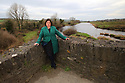Marie Brown, Women's Aid, Northern Ireland, stands on the Clady border bridge connecting the County Tyrone village of Clady and County Donegal. Feb 22, 2019.  Photo/Paul McErlane