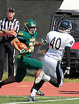 SEPTEMBER 13, 2014 -- Phydell Paris #34 of Black Hills State eyes South Dakota Mines defender James Carver #40 during their college football game Saturday at Lyle Hare Stadium in Spearfish, S.D.  (Photo by Dick Carlson/Inertia)
