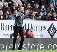 Manchester City manager Josep Guardiola shouts instructions to his team from the technical area<br /> <br /> Photographer Rich Linley/CameraSport<br /> <br /> The Premier League - Burnley v Manchester City - Sunday 28th April 2019 - Turf Moor - Burnley<br /> <br /> World Copyright © 2019 CameraSport. All rights reserved. 43 Linden Ave. Countesthorpe. Leicester. England. LE8 5PG - Tel: +44 (0) 116 277 4147 - admin@camerasport.com - www.camerasport.com