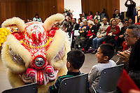 Young audience members become part of the show when a dragon confronts them during a Lunar New Year event.