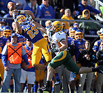 BROOKINGS, SD - SEPTEMBER 28:   Brandon Hubert #23 from South Dakota State University has the ball bounce off his fingers past the defense Colton Heagle #20 from North Dakota State University in the third quarter of their game Saturday afternoon at Coughlin Alumni Stadium in Brookings. (Photo by Dave Eggen/Inertia)