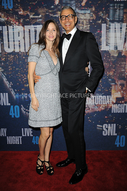 WWW.ACEPIXS.COM<br /> February 15, 2015 New York City<br /> <br /> Emilie Livingston and Jeff Goldblum walking the red carpet at the SNL 40th Anniversary Special at 30 Rockefeller Plaza on February 15, 2015 in New York City.<br /> <br /> Please byline: Kristin Callahan/AcePictures<br /> <br /> ACEPIXS.COM<br /> <br /> Tel: (646) 769 0430<br /> e-mail: info@acepixs.com<br /> web: http://www.acepixs.com