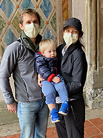 New York, New York City. A family portrait while wearing the recommended face coverings in Central Park due to Coronvirus.