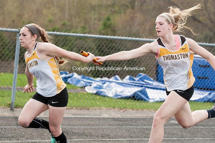 BURLINGTON, CT-5 May 2015-050515EC08-  Thomaston's Casey Carangelo passes the baton to Lexi Doty Tuesday in Burlington. Erin Covey Republican-American