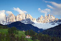 Val di Funes, Dolomite Mountains, South Tyrol, Italy. Val di Funes/Villnöss Valley is simply picture-perfect: a fairytale that is idyllic and enchantingly beautiful. The main landmark is the Odle/Geisler Dolomite Massif: its striking, pale towers of rock and mountain peaks make it the star of the show.