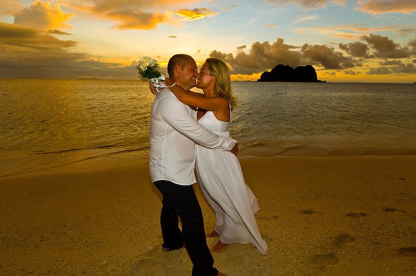 Wedding ceremony, Vomo Lailai at sunset in background, Vomo Island, Fiji Islands