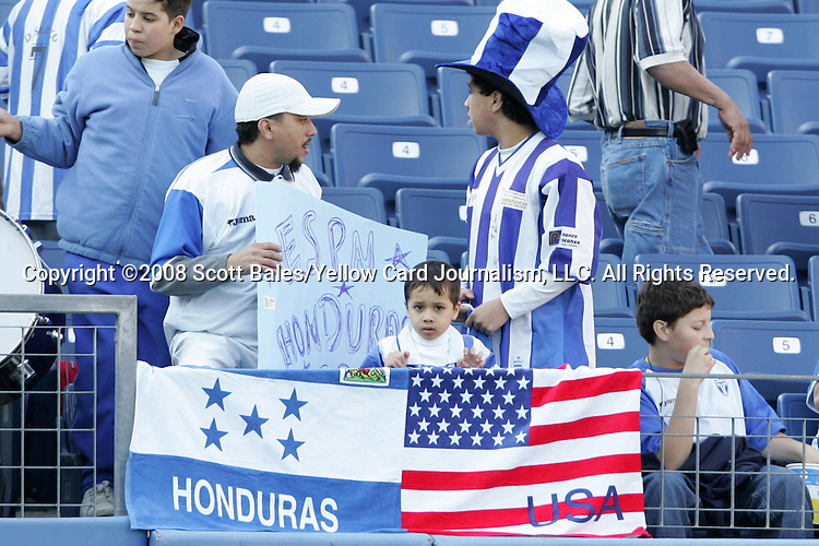 20 March 2008: Young fan stands behind flags of Honduras and the United States. The Honduras U-23 Men's National Team defeated the Guatemala U-23 Men's National Team 6-5 on penalty kicks after a 0-0 overtime tie at LP Field in Nashville,TN in a semifinal game during the 2008 CONCACAF Men's Olympic Qualifying Tournament. With the penalty kick victory, Honduras qualifies for the 2008 Beijing Olympics.