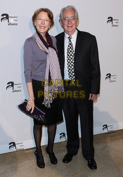 DONNA BECK WEAVER & ROGER WEAVER .The Independent School Alliance for Minority Affairs Gala   held at  Beverly Hilton Hotel, Beverly Hills, California, USA..April 21st, 2010.full length skirt married husband wife purple cardigan clutch bag black suit scarf pink.CAP/ADM/TC.©T. Conrad/AdMedia/Capital Pictures.