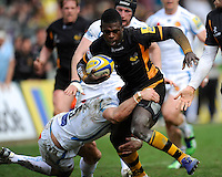 Christian Wade of London Wasps is tackled by Luke Arscott of Exeter Chiefs during the Aviva Premiership match between London Wasps and Exeter Chiefs at Adams Park on Sunday 21st April 2013 (Photo by Rob Munro)