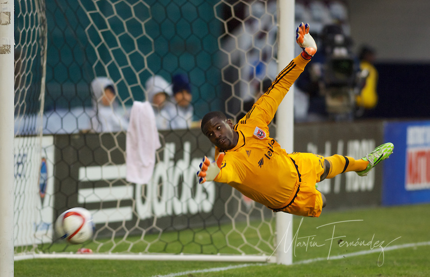 United's Bill Hamid dives for the ball. The shot would miss its mark narrowly wide. DC United defeated the LA Galaxy 1-0 with a stoppage time goal from Chris Pontius at RFK Stadium in Washington DC.