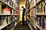 February 23, 2015. Durham, North Carolina.<br /> Daniel Stublen, a Duke undergraduate who works in the J. Michael Goodson Law Library, puts books back in the stacks.<br />  The Duke University School of Law is considered one of the best law schools in the country.